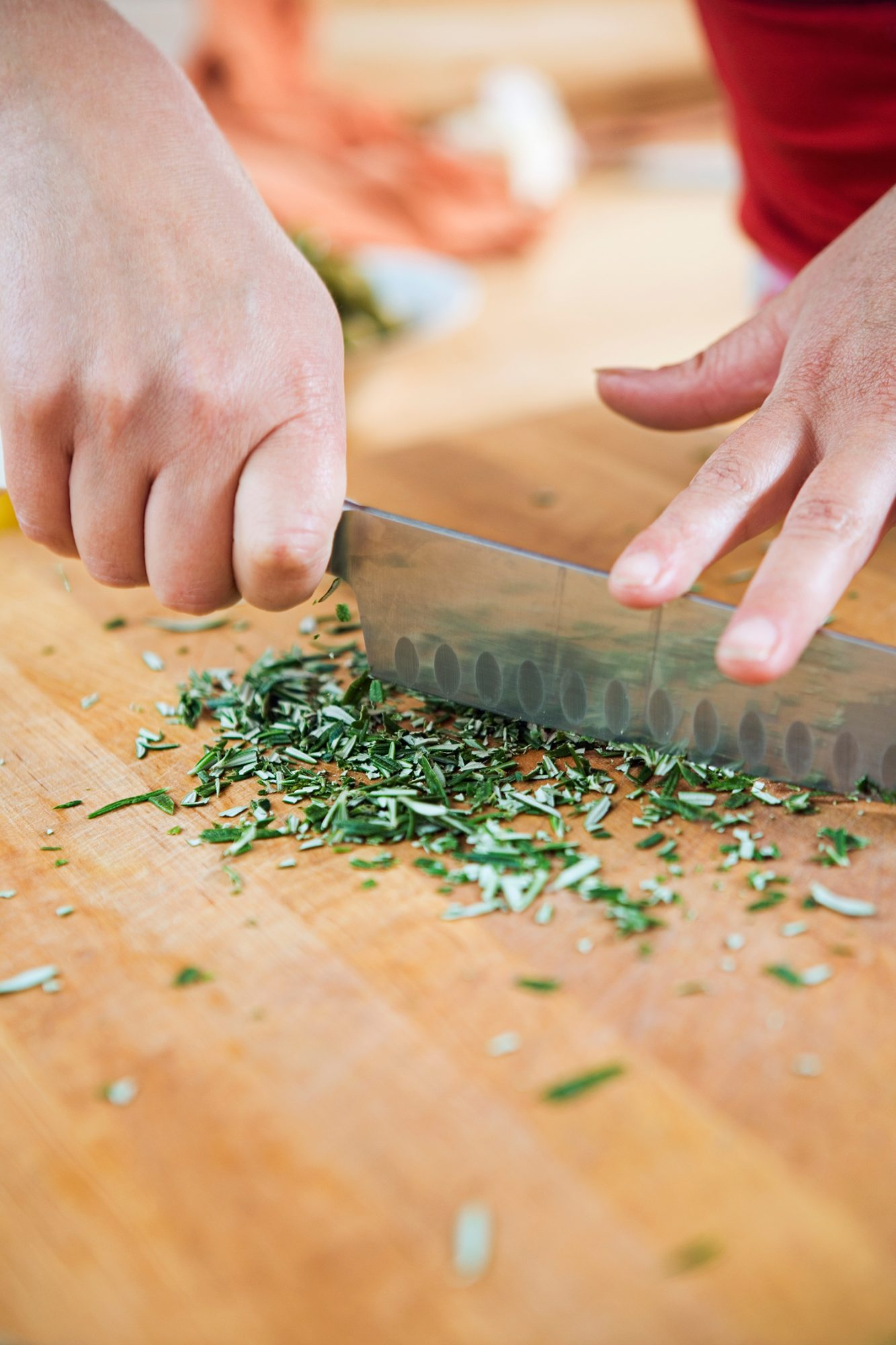 Chopping Rosemary and Thyme Closeup