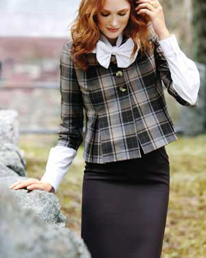 Woman wearing a plaid jacket and pencil skirt
