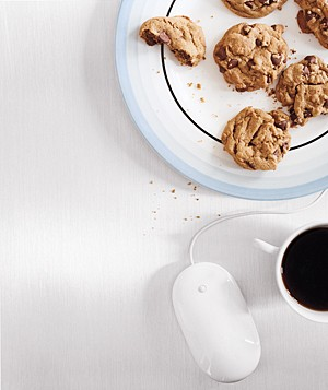Dish of cookies, a cup of coffee, and a computer mouse