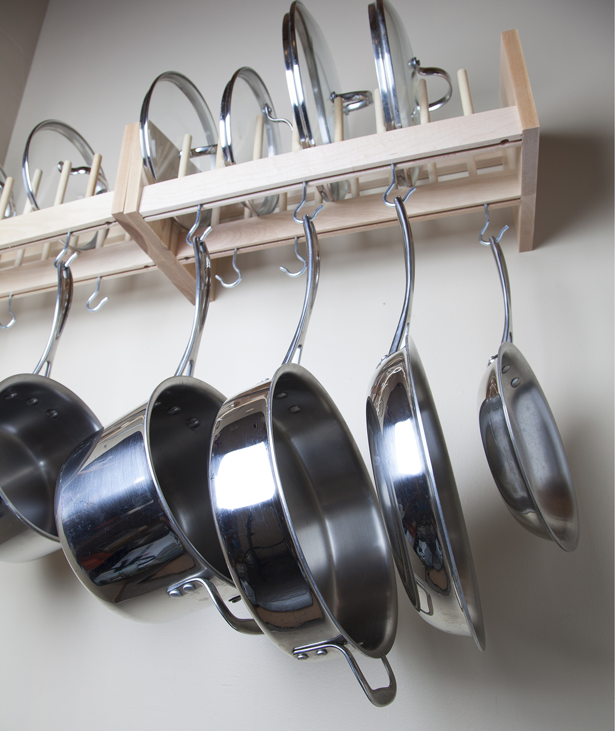 Pots and pans hanging from ceiling hook