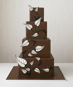 Tiered chocolate cake decorated with leaves