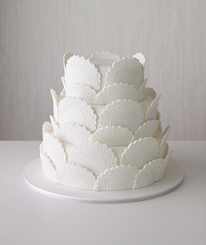 Wedding cake decorated with doilies