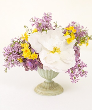 Centerpiece of purple peonies