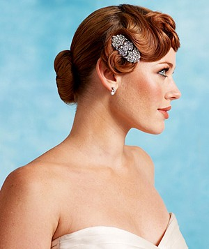 Bride with red hair in an updo