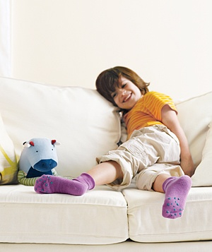 Little girl with puffy paint socks