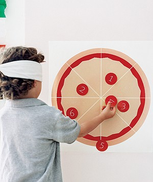 "Child playing ""Pin the Pepperoni on the Pizza"""