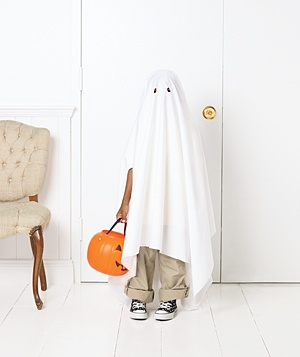 Child dressed as a ghost