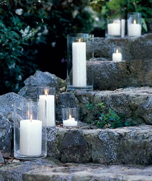 Lit candles outside on a stone stairway