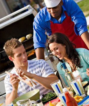 Man and woman eating BBQ