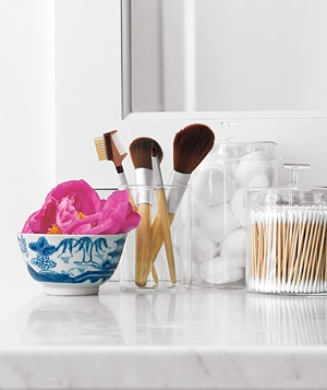 Makeup brushes, cotton balls, and cotton swabs