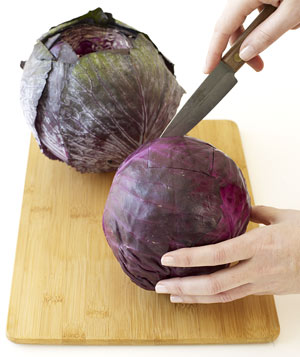 Cut a square hole in the top of each cabbage