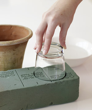 Push glass into floral foam