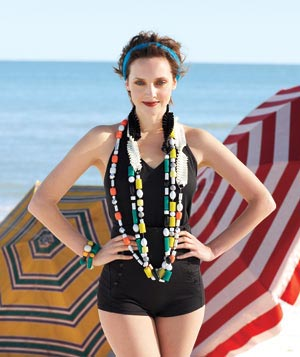 Woman on the beach wearing chunky necklaces