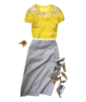 Yellow sequined sweater with horizontal-striped skirt, silver shoes, bracelet