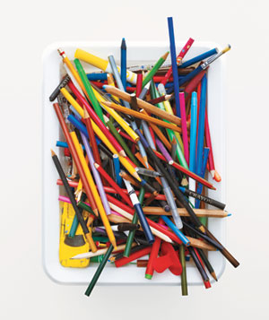 Colored pencils in a white bin