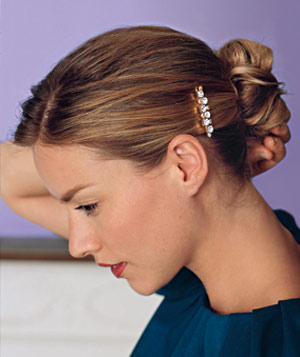 Woman with hair up in jeweled clip
