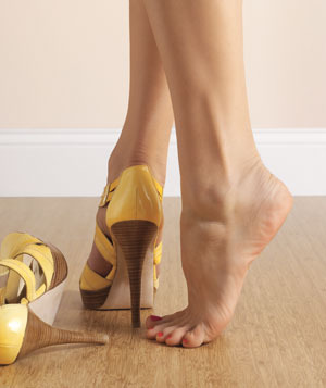 One foot in a high heel and one bare foot