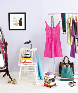 Purple room with clothing rack and miscellaneous items
