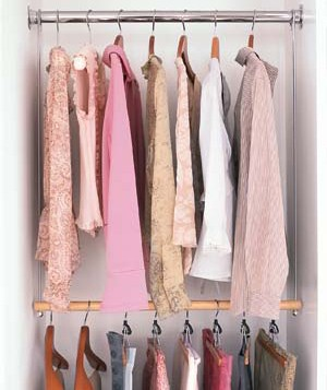 Blouses and skirts hanging on double rods