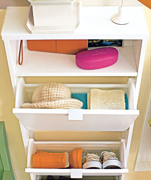 A sleek cabinet with bin drawers makes a clever hideaway for entryway clutter.