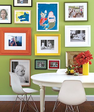 Wall covered with framed artwork