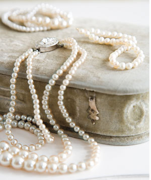 Pearl and diamond necklace on a jewelry box