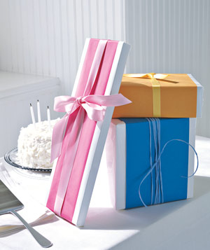 A simple band of paper adds color, while a ribbon in a similar tone ties it all together.