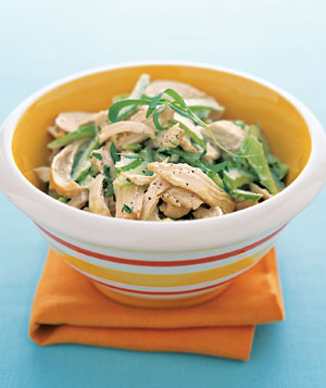 A garnish of tarragon leaves finishes off fresh chicken salad.