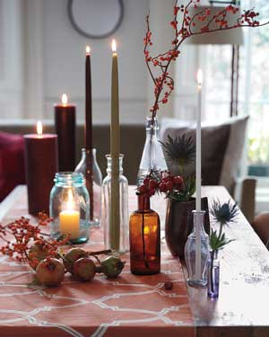 Candles in empty bottles