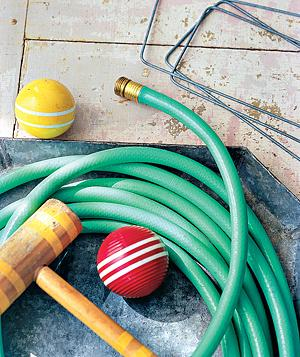 Croquet wickets and a garden hose