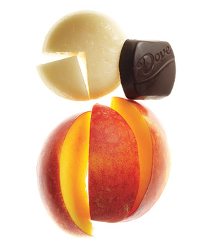 A peach, low-fat cheese, and a piece of dark chocolate