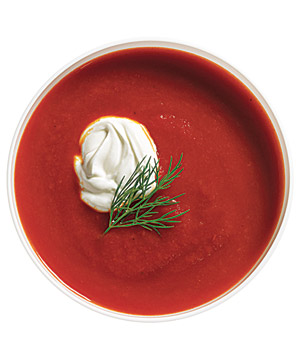 Bowl of pureed tomato soup and a dollap of low-fat sour cream