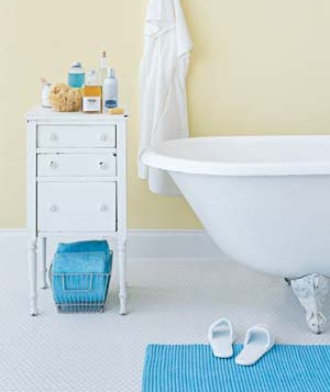 Nightstand and bathtub in a bathroom