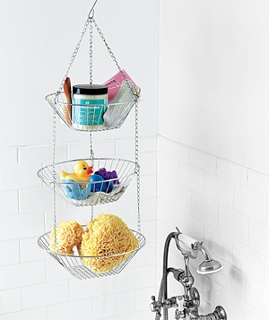 When your tub lacks wide ledges where you can stow your bath products, hang a multilevel fruit basket for additional space.