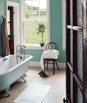 A calming color on the walls―like this rich blue-green―gives the room a sense of tranquillity.