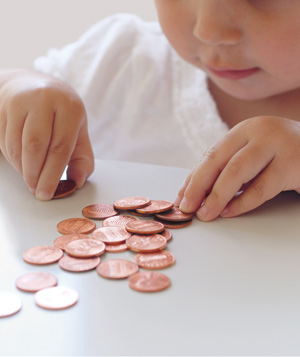 Child counting pennies