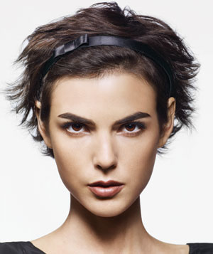 Model with a headband in short brown tousled hair