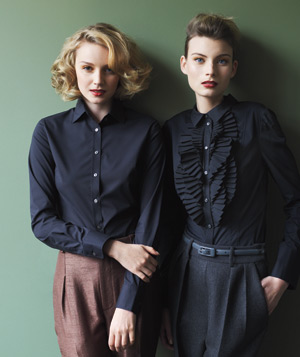 Models wearing black button-down shirts