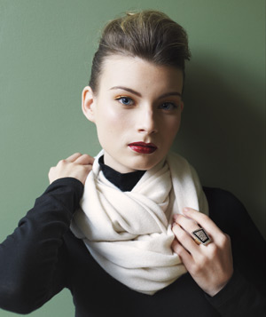 Model wearing a white Magaschoni cashmere infinity scarf
