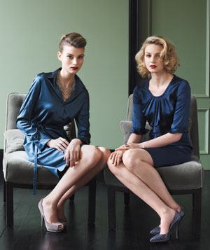 Models wearing blue jewel-toned silk dresses