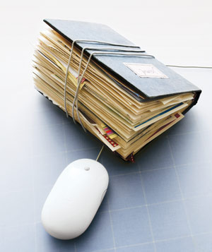 A journal with a mouse wire wrapped around it