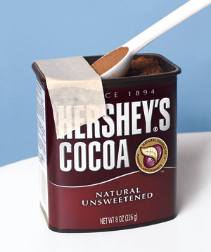 Masking tape as a scoop scraper on a Hersey's cocoa container