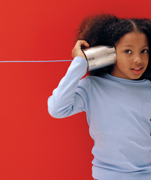 Young girl playing telephone with a can and a string