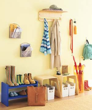 Keep the multitude of belongings that seem to accumulate in a hallway in check with a variety of hooks, racks, and bins. Assign each family member one of the latter for mail or school papers.
