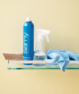 Spray bottle next to hair spray in a bathroom