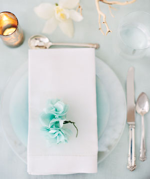 Place setting with a paper flower