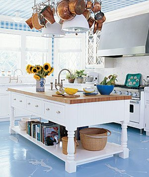 Kitchen with blue checked ceiling, blue floor, brass hanging pots and sunflowers on island countertop