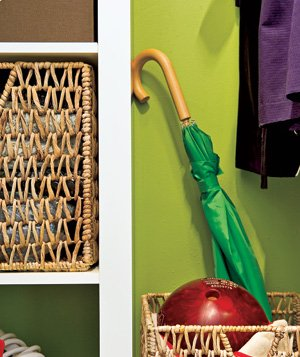 Green Umbrella and bowling ball in closet containers