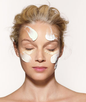 Model with moisturizers on her face
