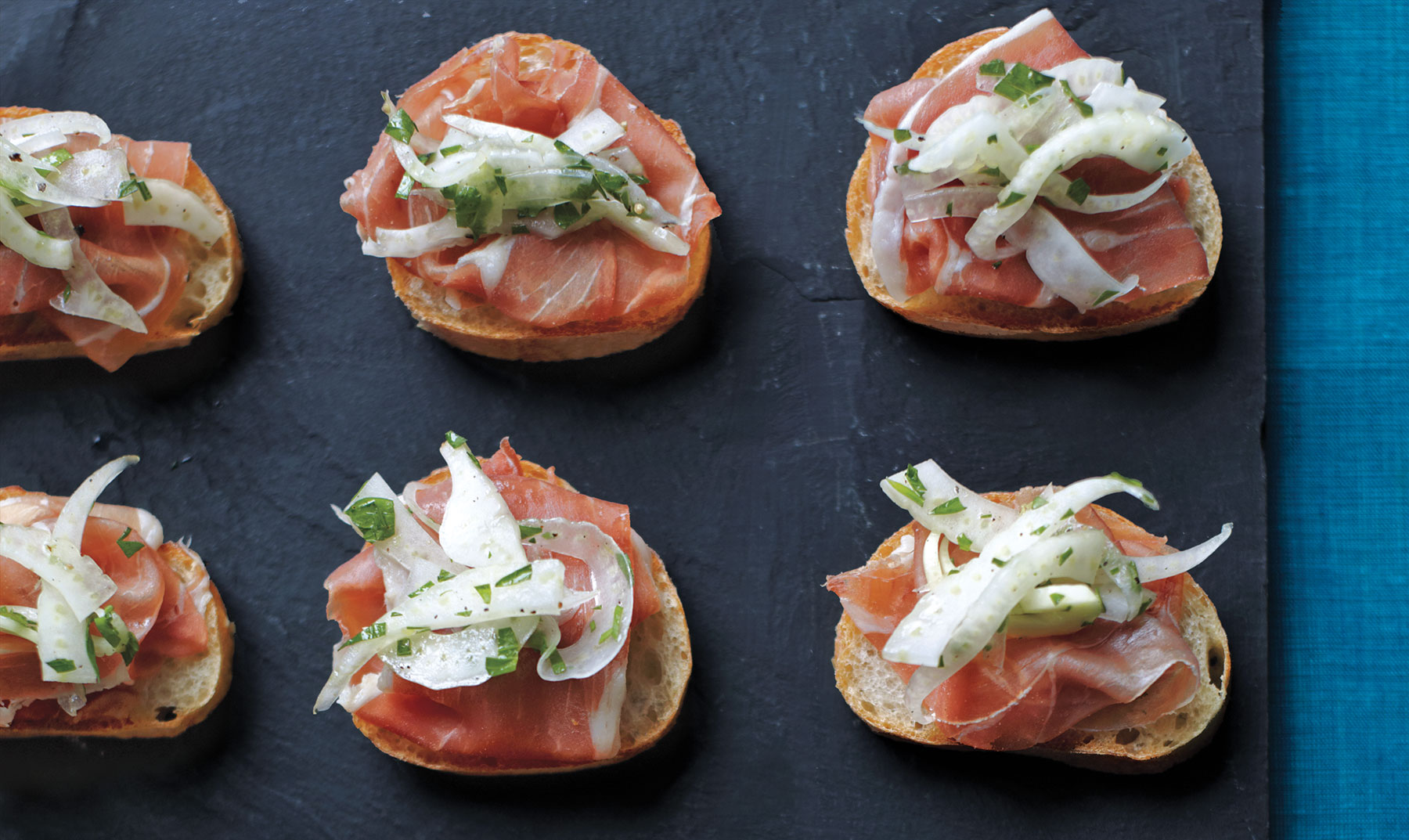 Prosciutto Crostini With Lemony Fennel Slaw